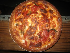 close up view of tomato basil and mozzarella pie